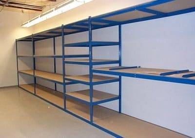 blue shelving with wood bottoms
