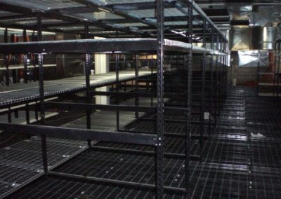 black shelving upper mezzanine
