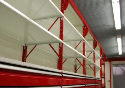 red shelving with drawers