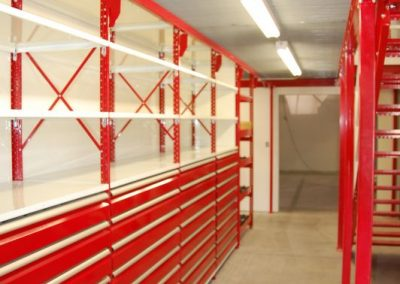 red and white shelving with drawers