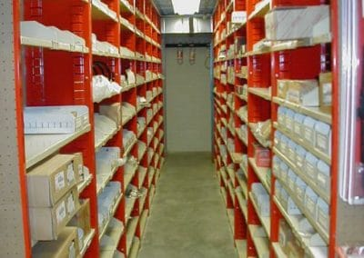 red shelving with products