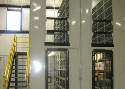 gated door with shelving