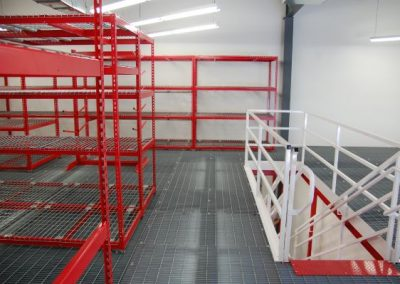 mezzanine with shelving and stairs